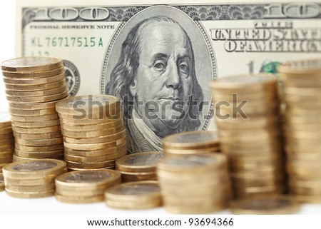 dollar denominations with fine coins - stock photo