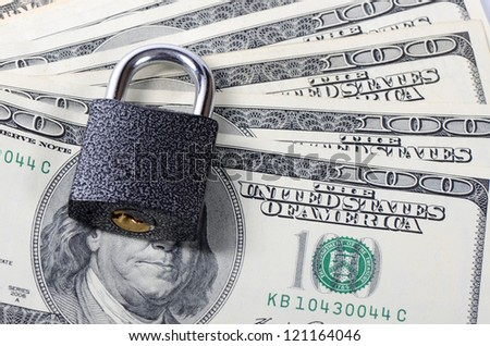 Dollar denominations with the lock close up - stock photo