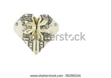 Dollar folded into heart - stock photo