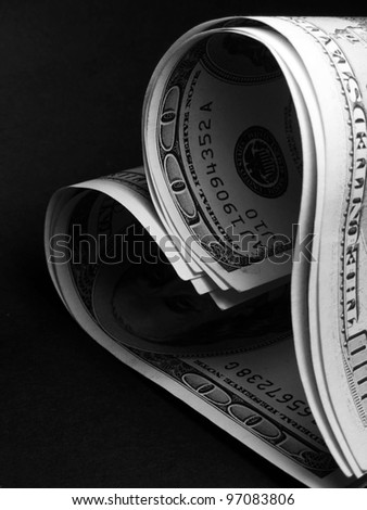 Dollar heart shape on black background - stock photo