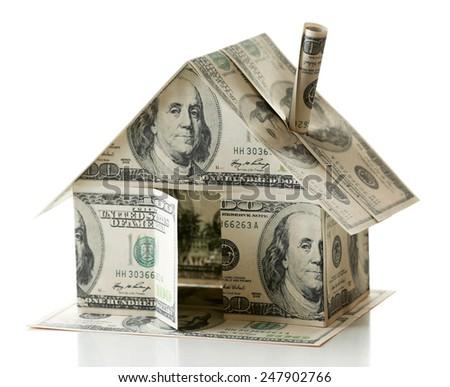 Dollar house isolated on white - stock photo