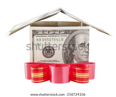Dollar house with red bow isolated on a white background - stock photo