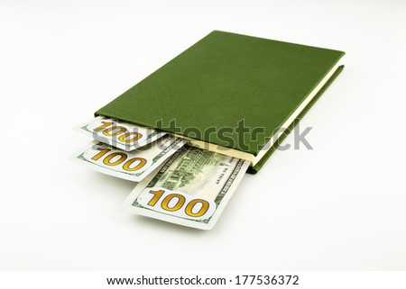 dollar money banknotes and book, tuition fee, payment and business concept - stock photo