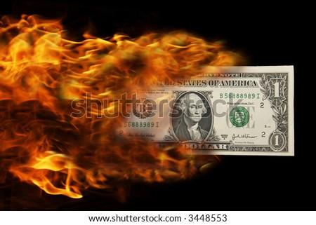 Dollar on fire - stock photo