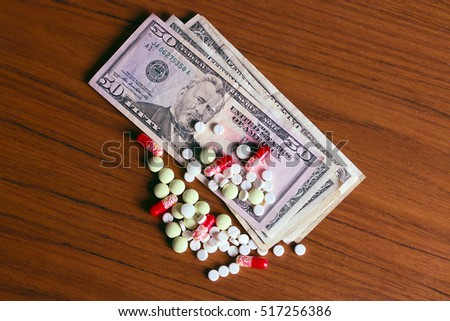 Dollar paper banknotes and medicine drugs and tablets as part of paid health care and treatment