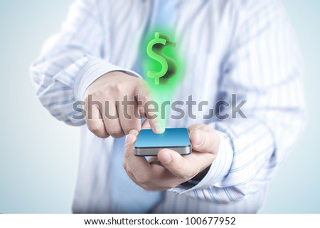 Dollar Sign Coming out of Touch screen mobile phone. Concept of business growth - stock photo