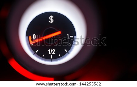 Dollar sign fuel gauge at empty. - stock photo