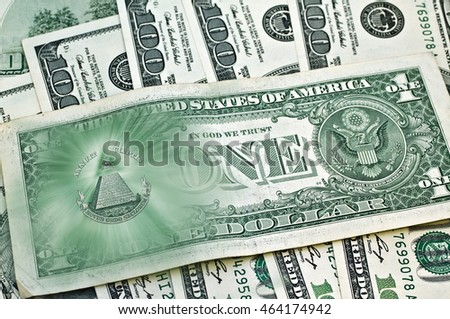 Dollar USA. Image United States one-dollar bill, pyramid, Eye of Providence, Beams from pyramid every which way, over banknotes hundred dollars. Conceptual photo for successful business design. Macro.