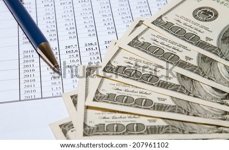 Dollars and blue pen on documents background - stock photo