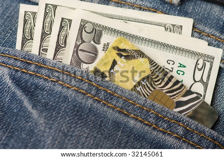 dollars and credit card in jeans pocket