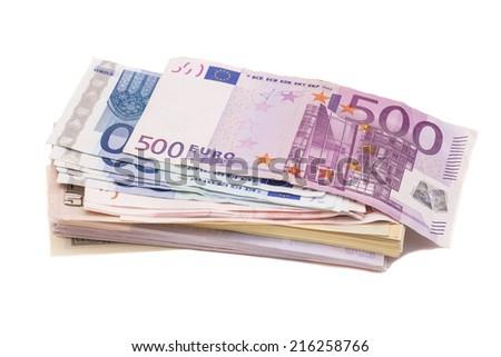 Dollars and euro money on white - stock photo