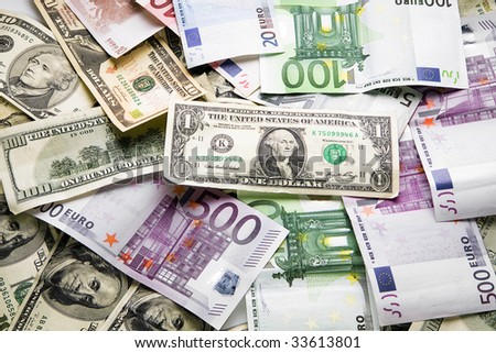 Dollars and euro pile heap  close up on white background   - stock photo