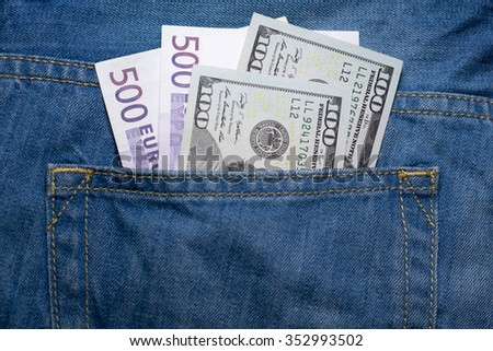 Dollars and euros in a jeans backpocket