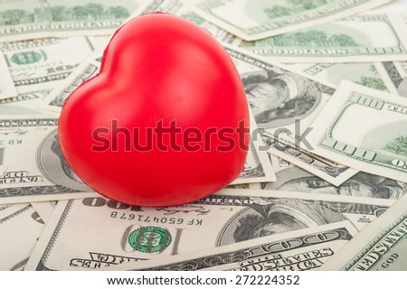 Dollars and red  heart - stock photo