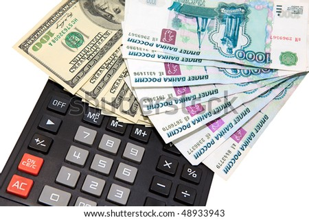 Dollars and russian money against the calculator, converting, investments