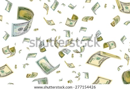 Dollars are flying in the air. - stock photo