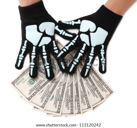 dollars bills and skeleton hands isolated on white, money - stock photo