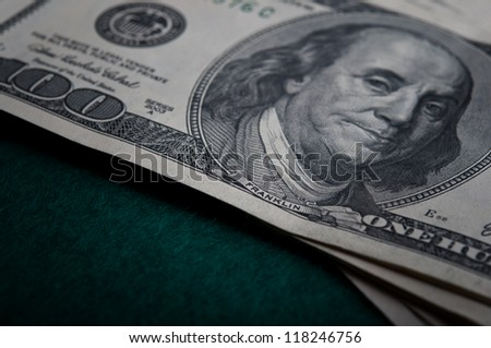 dollars bills on green background - stock photo