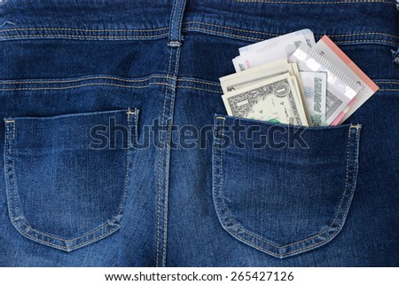 Dollars, euro and russian roubles in jeans pocket - stock photo