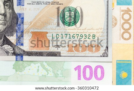 dollars, euros and tenge as background
