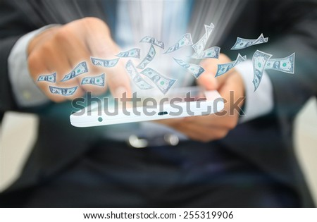 Dollars flying out of the tablet.business concept - stock photo