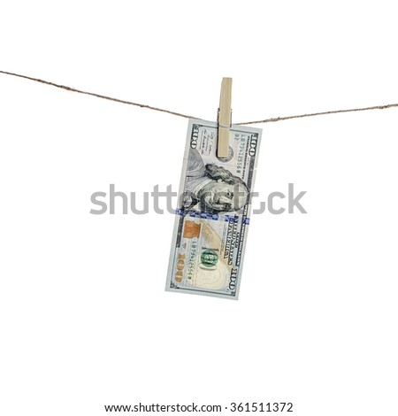 Dollars hang on clothes-rope isolated on white