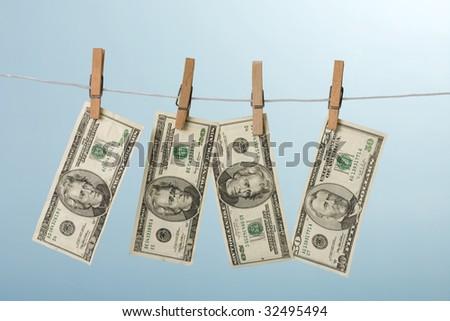 dollars hanging on line - stock photo