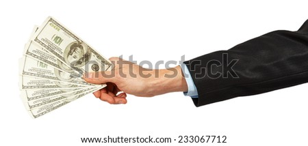 Dollars in a hand of the businessman isolated on white background