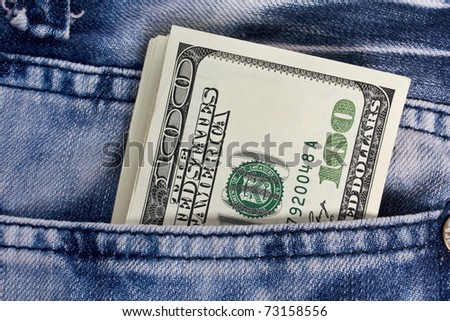 dollars in a jeans pocket, closeup