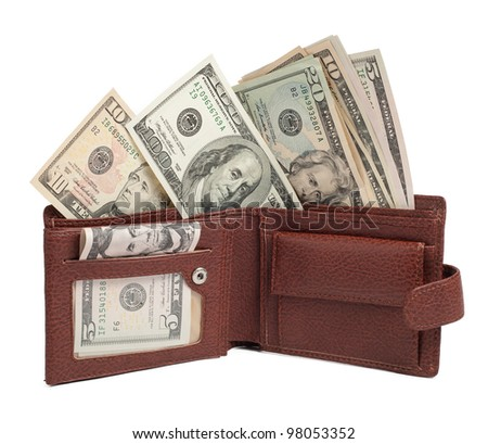 Dollars in brown wallet isolated on white - stock photo