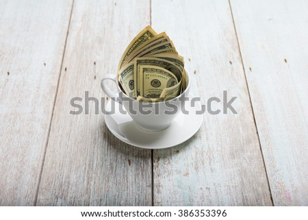 dollars in cup - stock photo