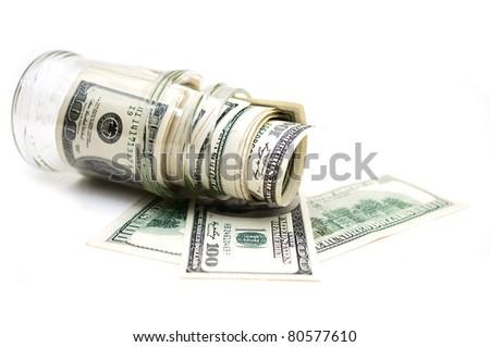 dollars in money jar - stock photo