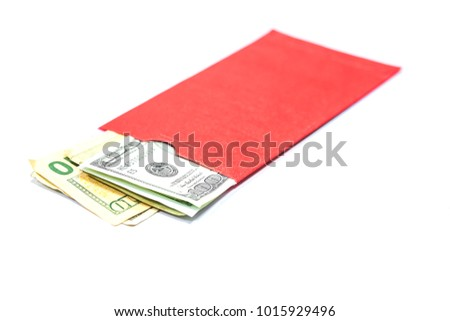 Dollars in red envelope isolated on a white background.