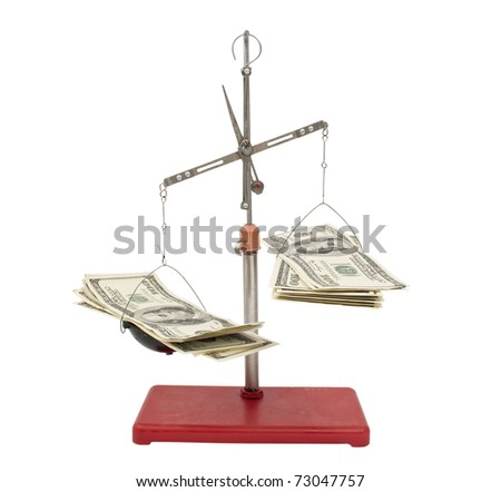 dollars in the balance on a white background - stock photo