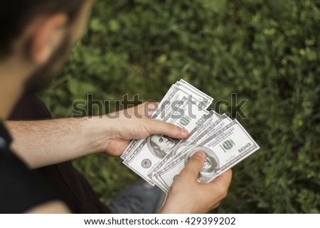 Dollars in the hands