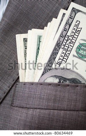 dollars in the pocket of business suit - stock photo