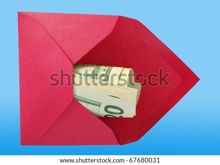 Dollars in the red open envelope isolated on a blue background with work paths. - stock photo