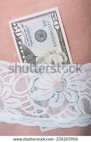 Dollars in woman stocking - stock photo