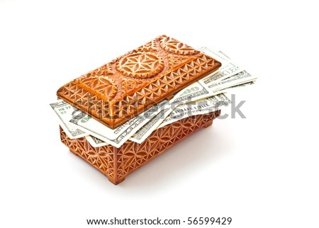 Dollars in wooden box isolated on white. With soft shadow