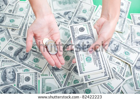 dollars into the hands against the background of the money