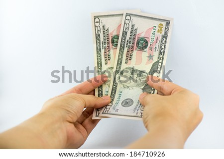 dollars money in business man's hand