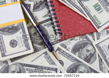 Dollars, notebook and pen, money background
