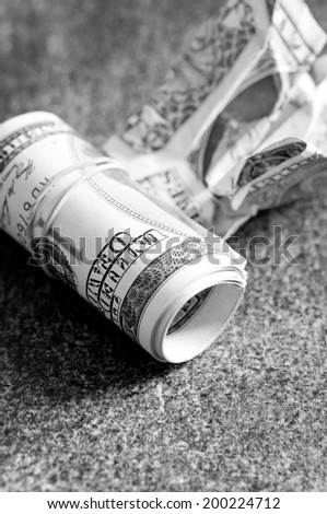 Dollars on a black - stock photo