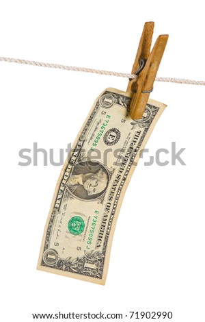 Dollars on clothespin isolated on white background