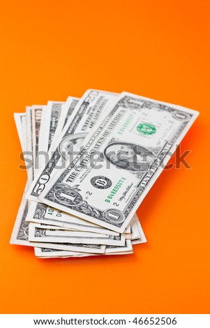 dollars on color background