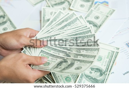 dollars on hand,Cash in hands. Profits, savings. Stack of dollars. man counting money,man in business clothes with dollars, Success, motivation, financial flows, wealth. Stack of dollars