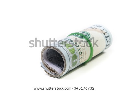 Dollars roll on white background