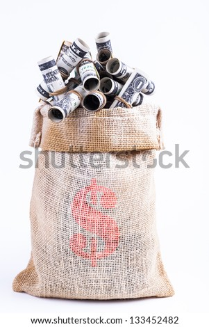 Dollars rolled up with rubber band in Sack isolated on white background - stock photo