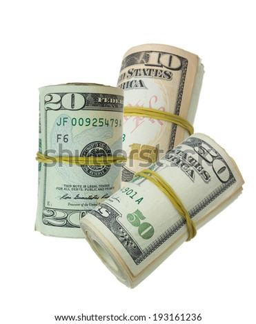 dollars rolled up with rubberband isolated on money background