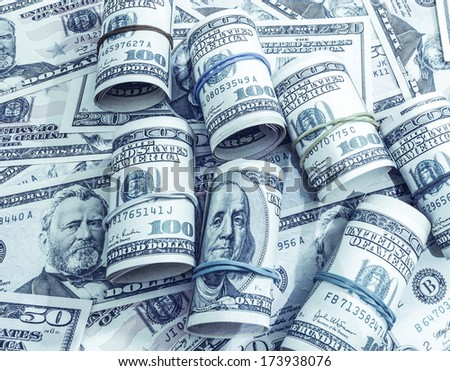 Dollars seamless background. High resolution wallpaper texture of rolled in a tube one hundred and flat fifty banknotes toned in blue - stock photo